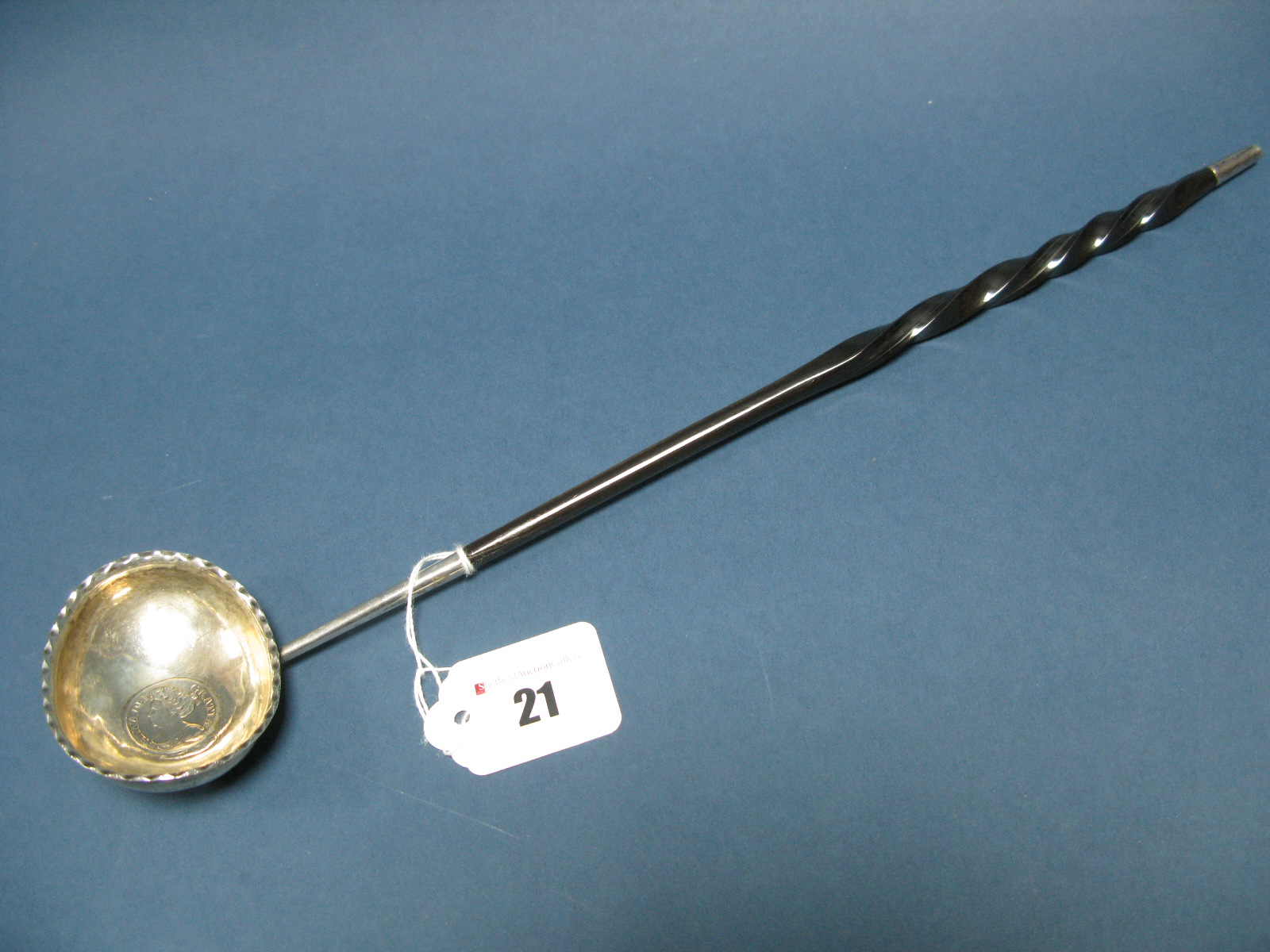 Lot 21 - A Georgian Toddy Ladle, the oval bowl with textured edge and coin inset detail, overall length 36.