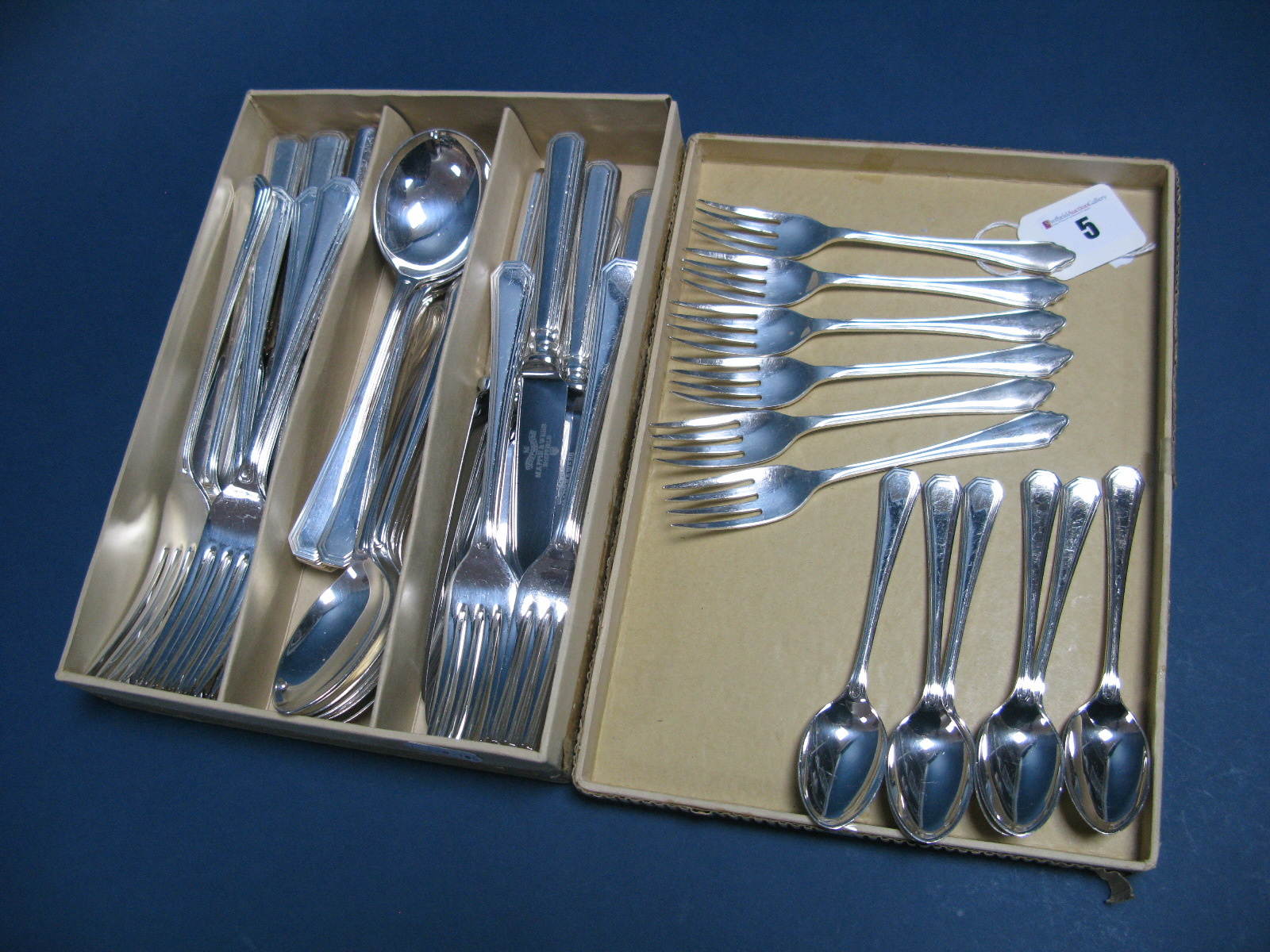 Lot 5 - A Mappin & Webb Plated Forty Two Piece Cutlery Set, together with a set of six Dubarry style cake
