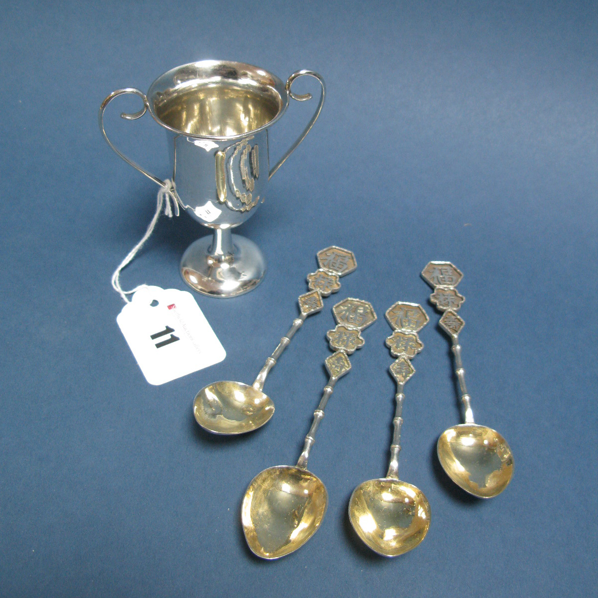 Lot 11 - A Set of Four Chinese Teaspoons, each with character marks to bamboo style handles, stamped marks