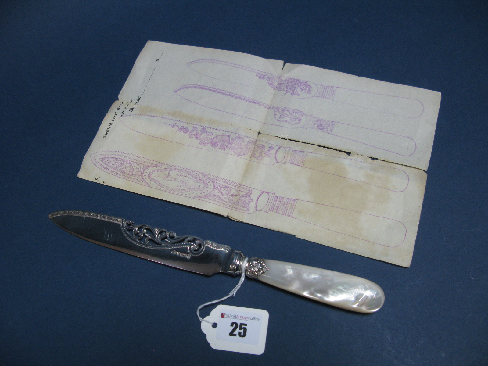 Lot 25 - A Highly Decorative Mother of Pearl Handled Cake Knife, with openwork scroll detail to the blade,