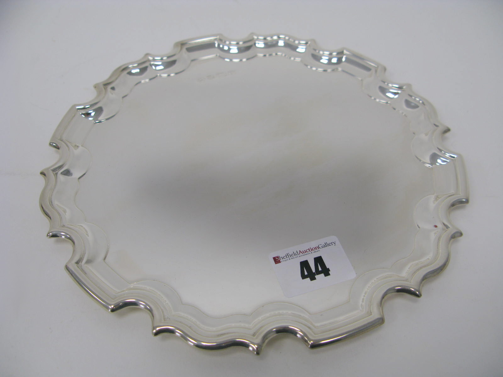 Lot 44 - A Hallmarked Silver Waiter, RC, Sheffield 1995, of shaped circular form, 20.3cm diameter, 325grams.