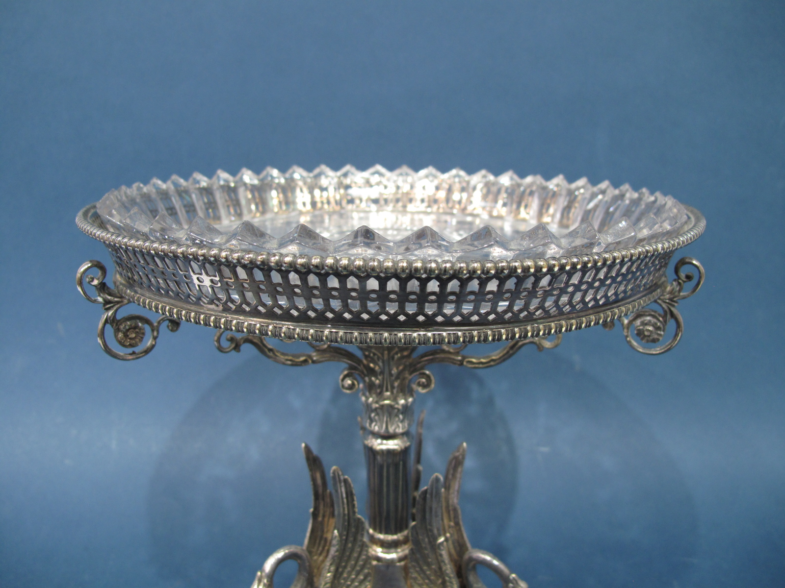 Lot 23 - A James Dixon & Sons Plated Tazza, the triform base with applied swans, raised on openwork shell and
