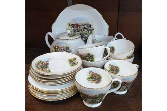 A bone china six piece tea set decorated with fox hunting scenes