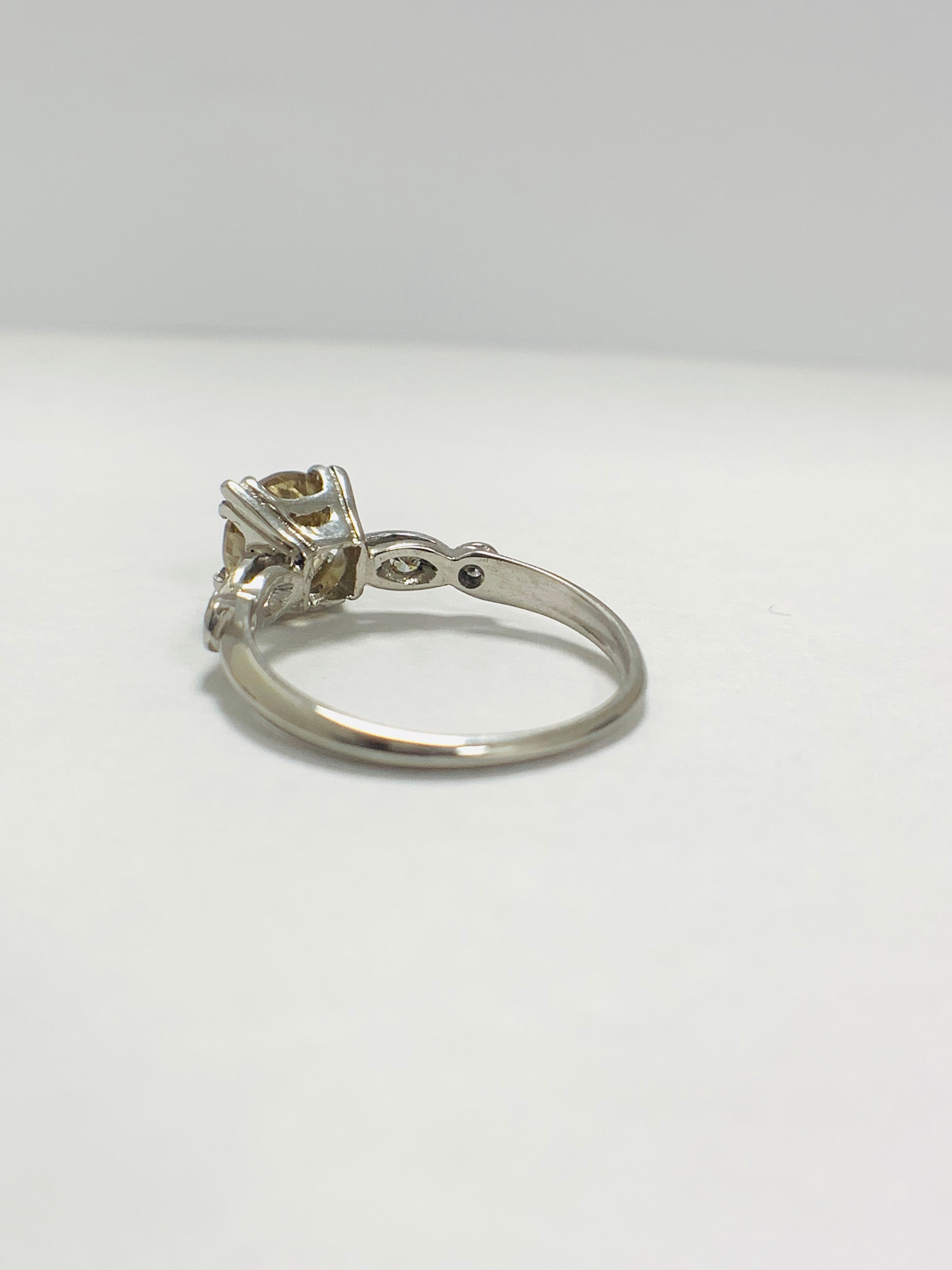 Platinum Diamond ring featuring centre, round brilliant cut, fancy light brown Diamond (1.55ct) - Image 4 of 14