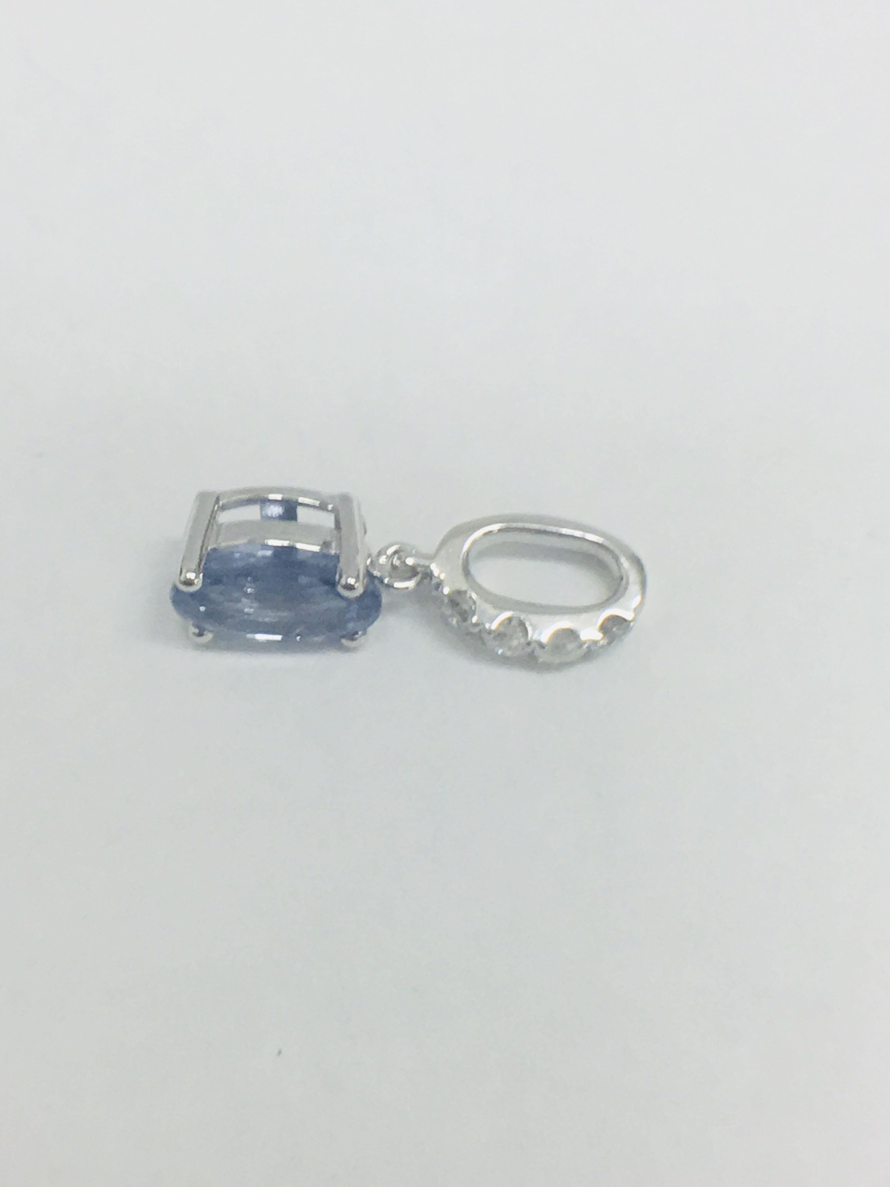 Lot 23 - 14ct White Gold Sapphire & Diamond Pendant.