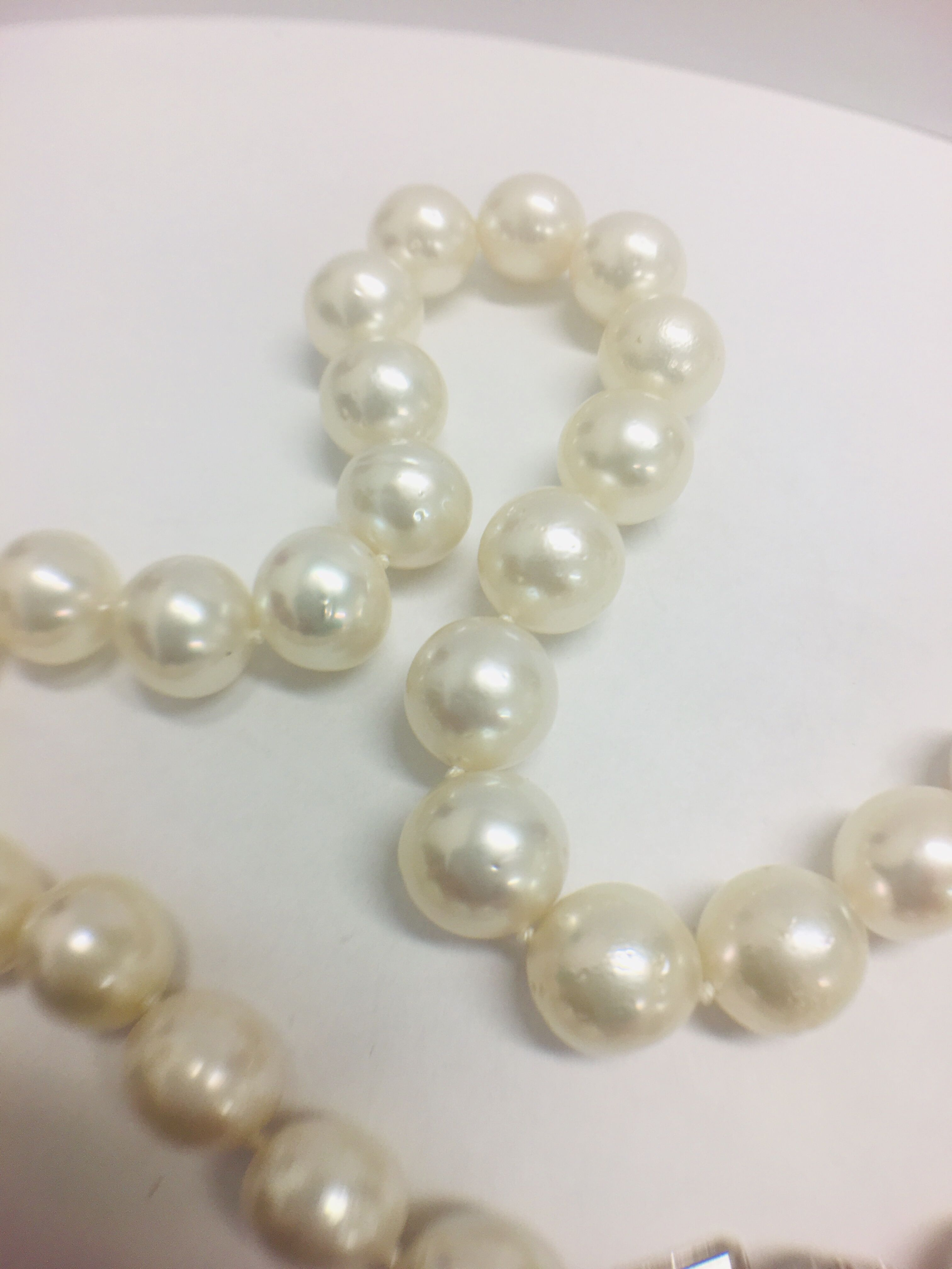 Lot 27 - Strand 35 South Sea Pearls with 14ct White Gold Filagree Style Ball