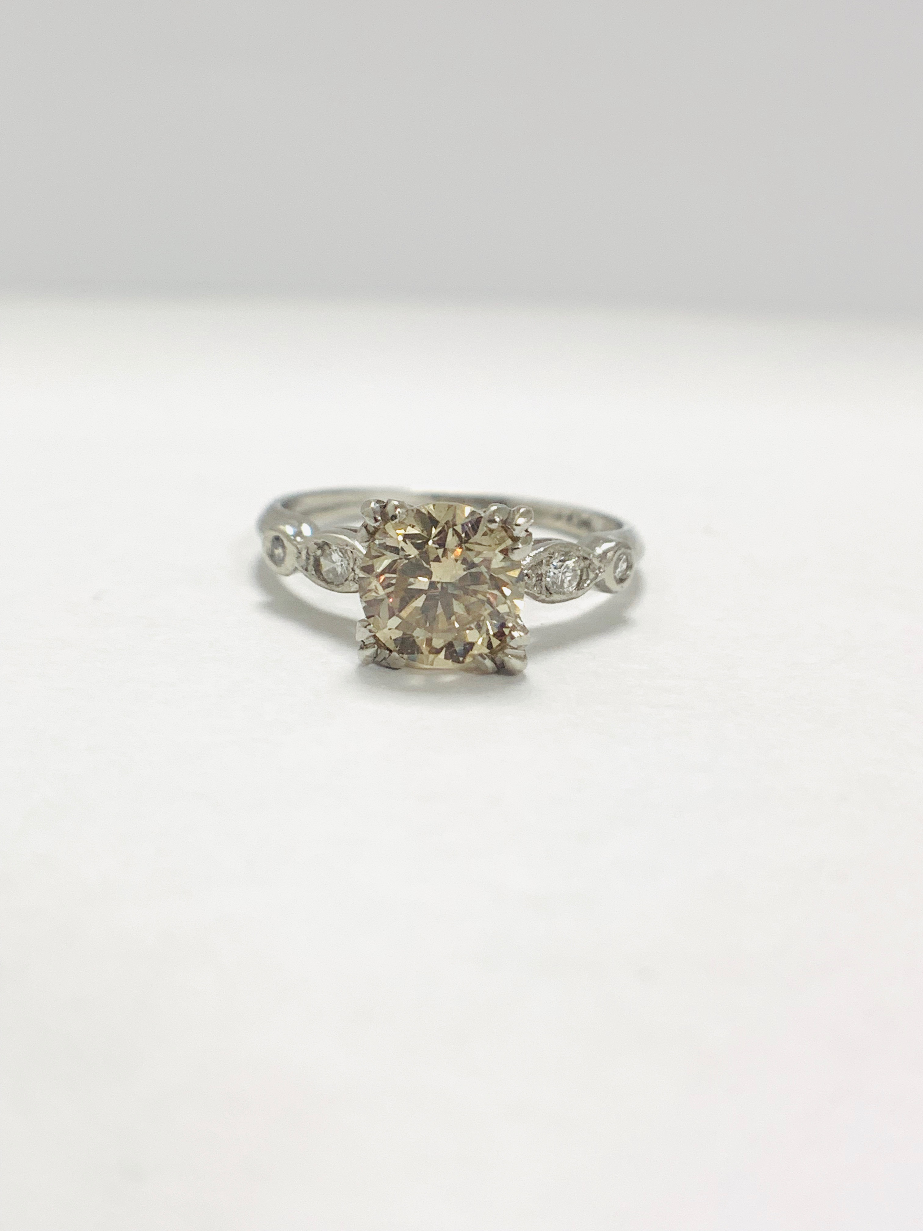 Platinum Diamond ring featuring centre, round brilliant cut, fancy light brown Diamond (1.55ct)