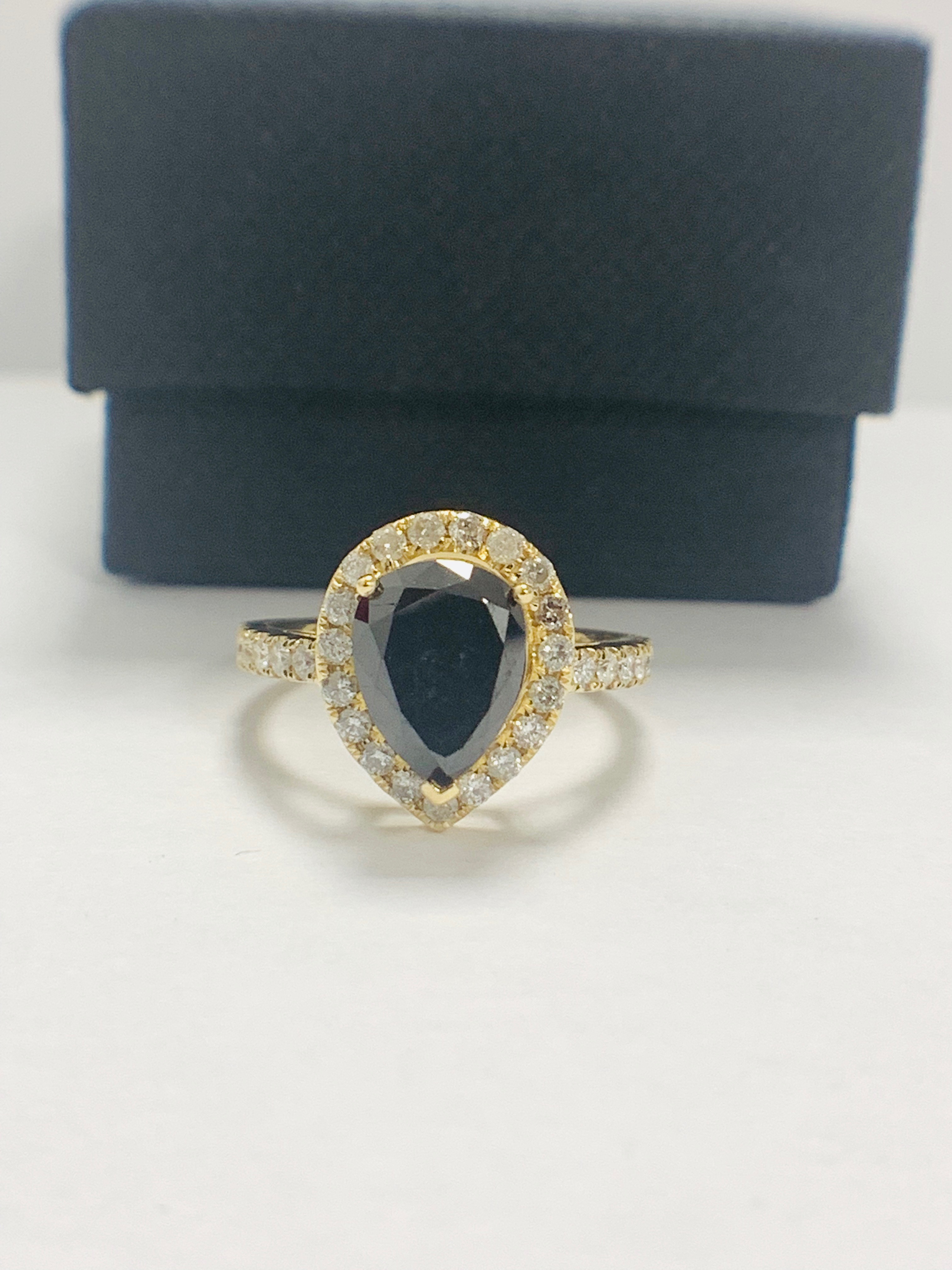 Lot 62 - 14ct Yellow Gold Diamond ring featuring centre, pear cut, black Diamond (2.13ct)