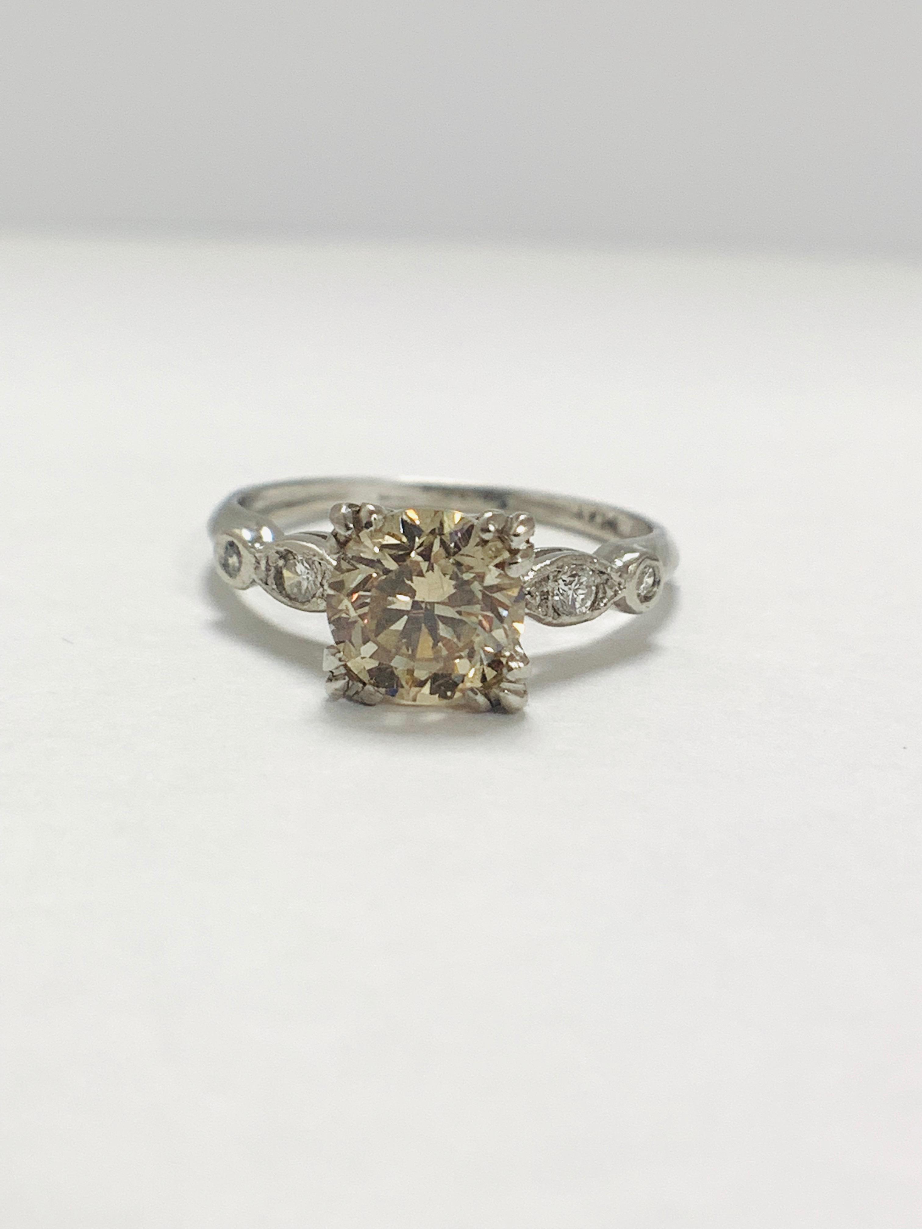 Platinum Diamond ring featuring centre, round brilliant cut, fancy light brown Diamond (1.55ct) - Image 9 of 14