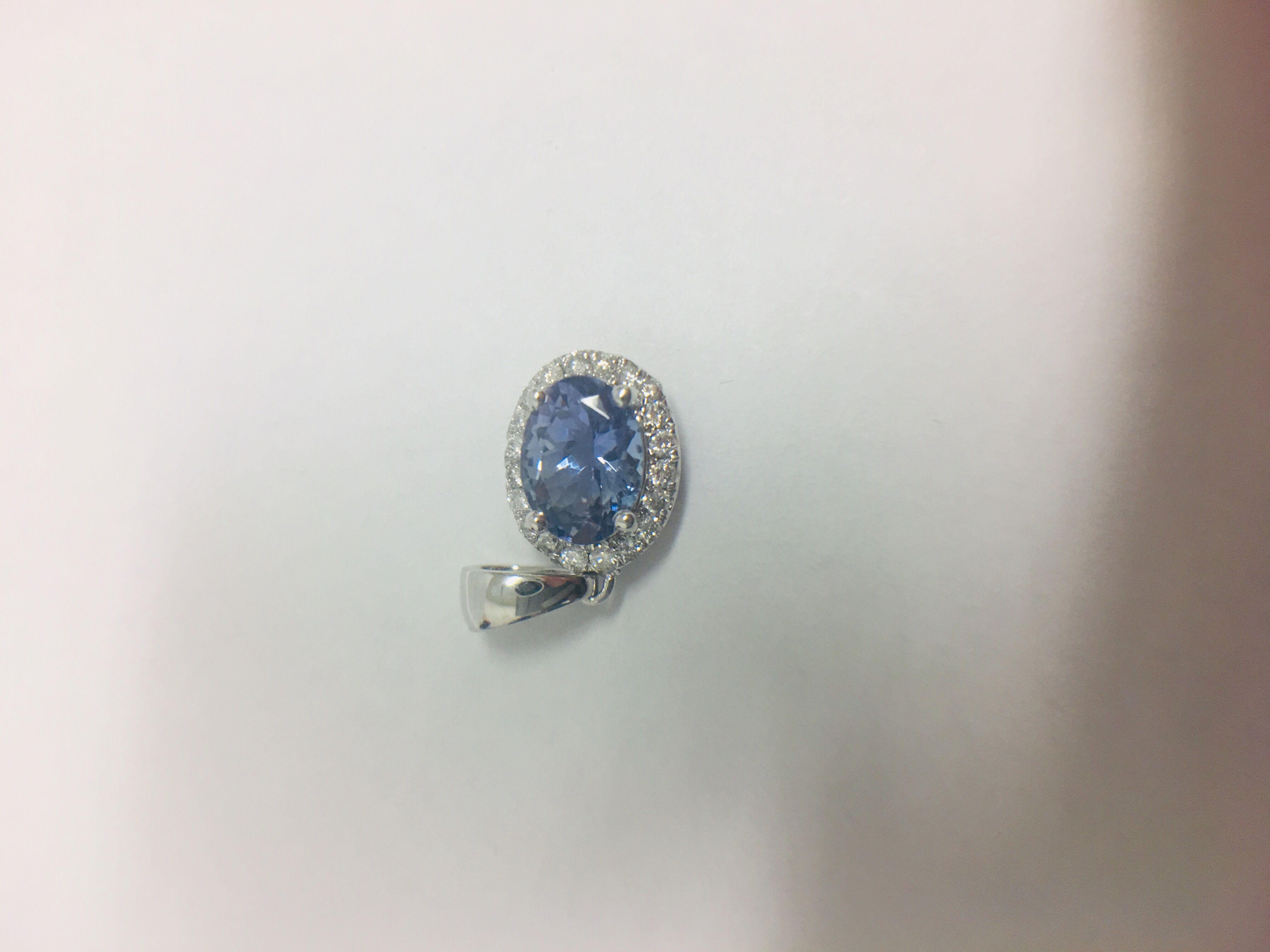 Lot 28 - 14ct White Gold Tanzanite & Diamond Pendant