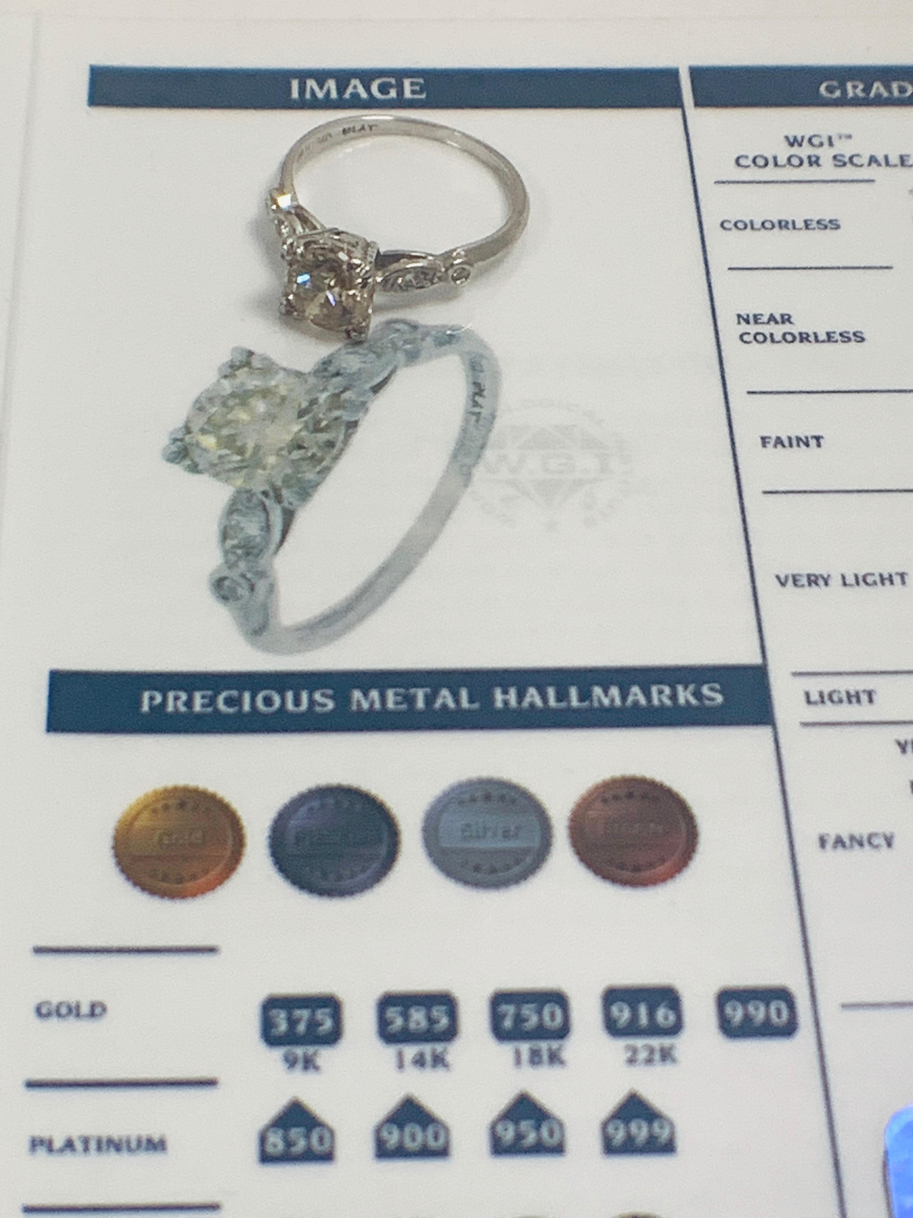 Lot 50 - Platinum Diamond ring featuring centre, round brilliant cut, fancy light brown Diamond (1.55ct)
