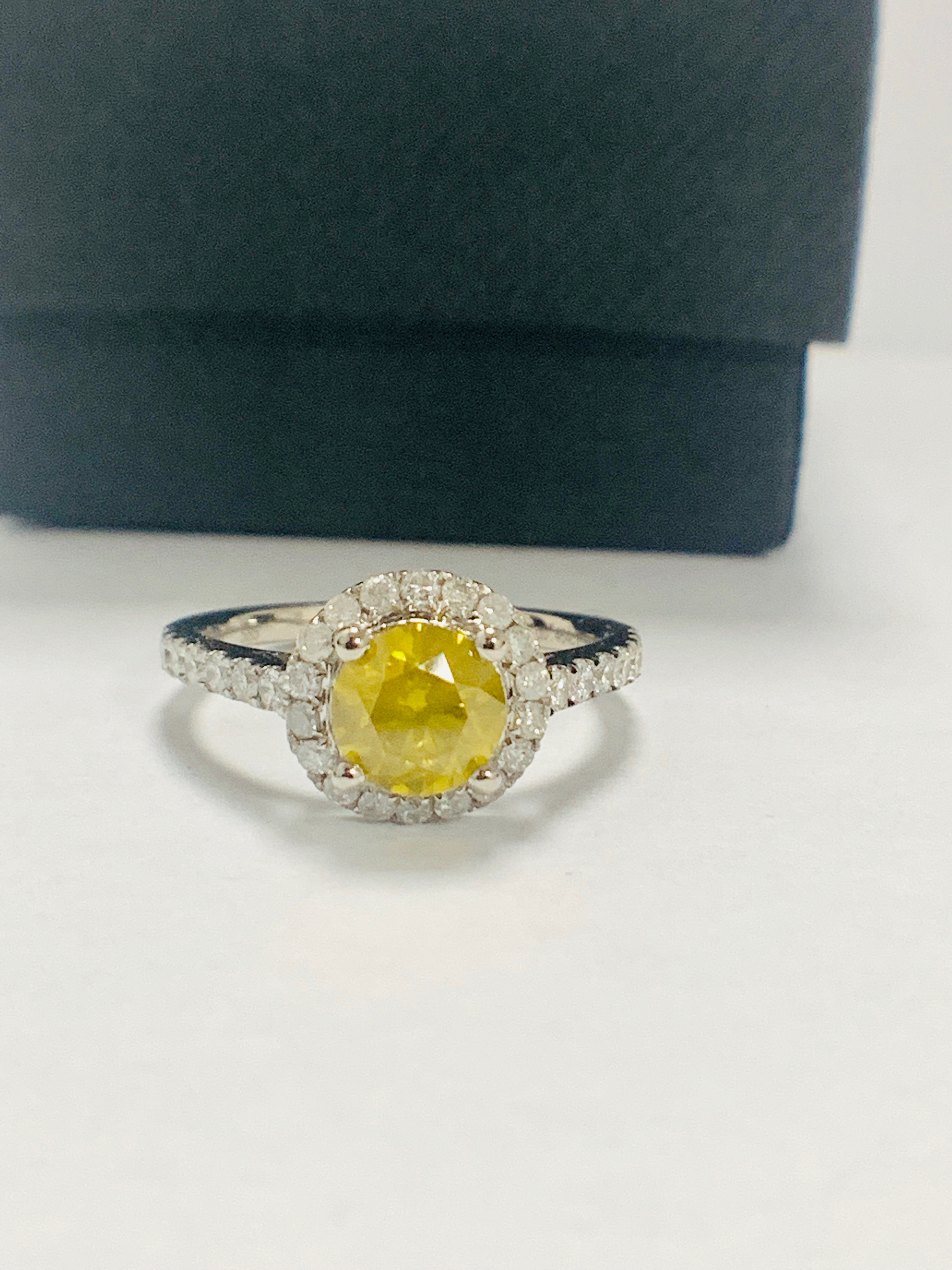 Lot 63 - 14ct White Gold Diamond ring featuring centre, round brilliant cut, yellow Diamond (1.08ct)
