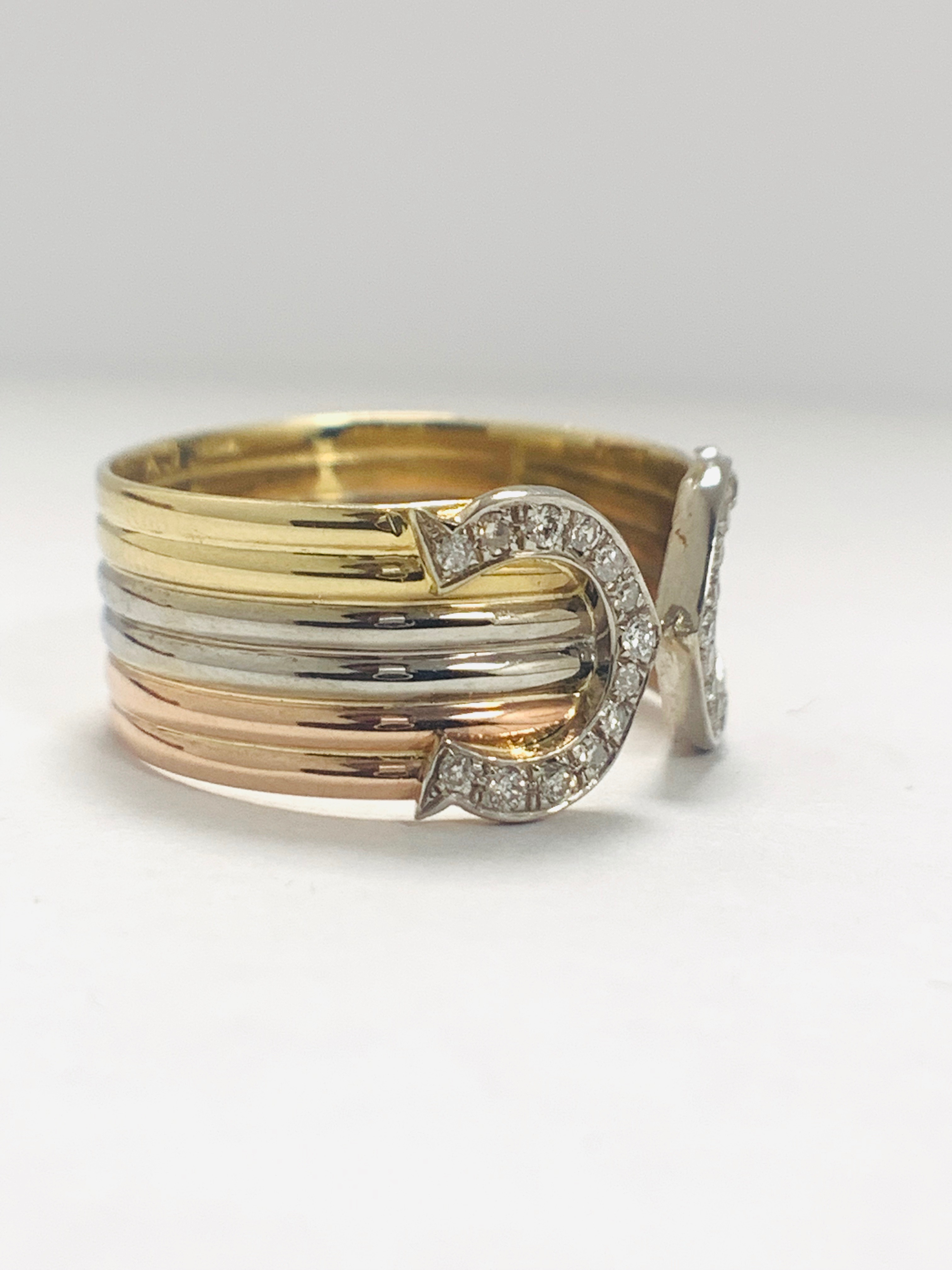 Lot 59 - 18ct 3 Toned Gold Diamond Chanel Ring