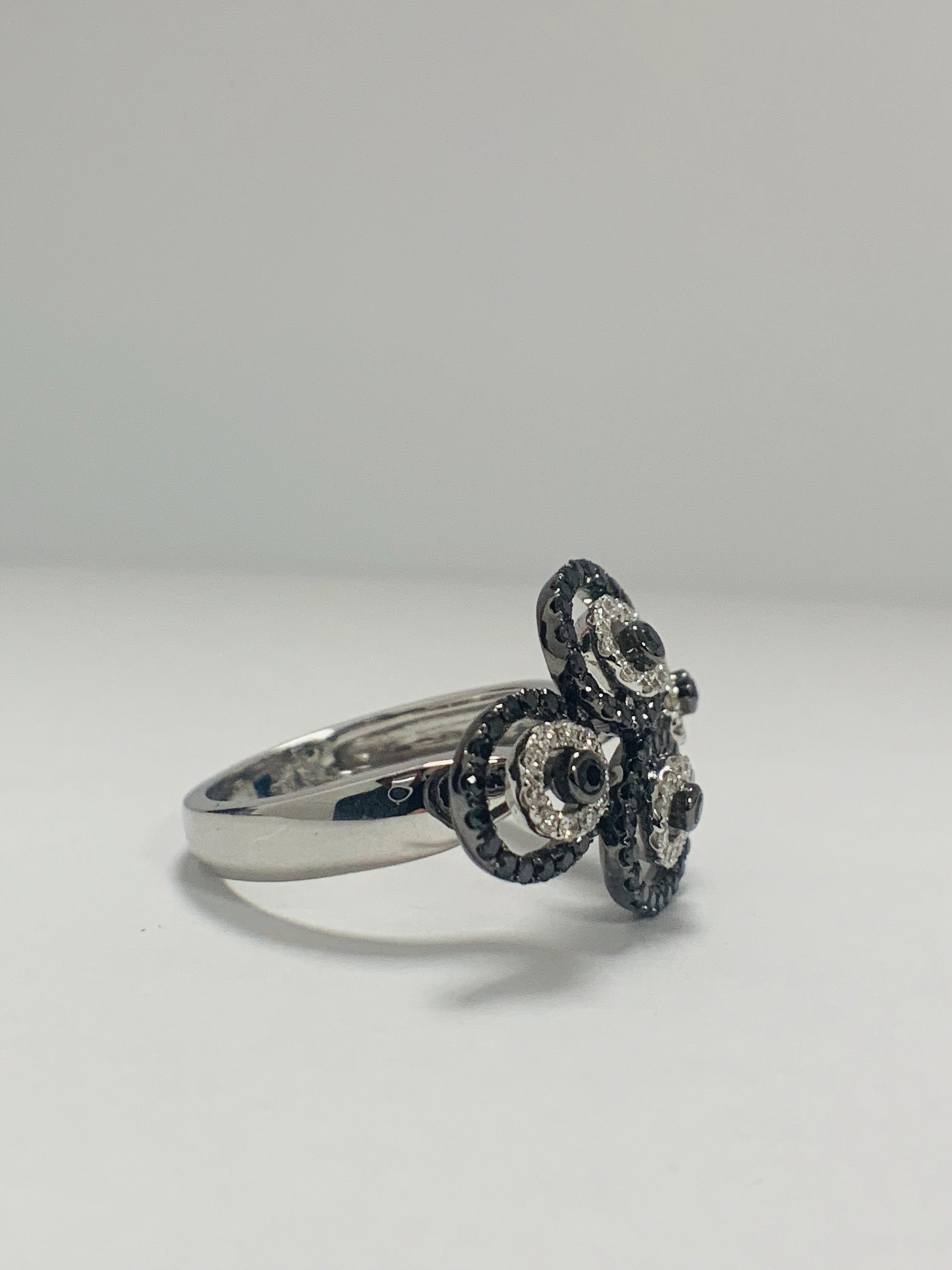 Lot 57 - 18ct White Gold Diamond Ring Featuring 80 Round Cut, Black Diamonds (0.61ct TBDW)
