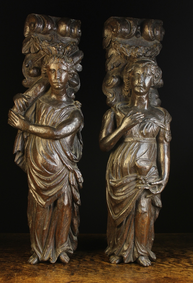Lot 43 - A Pair of 17th Century Carved Oak Figural Supports in the the form of ladies dressed in flowing