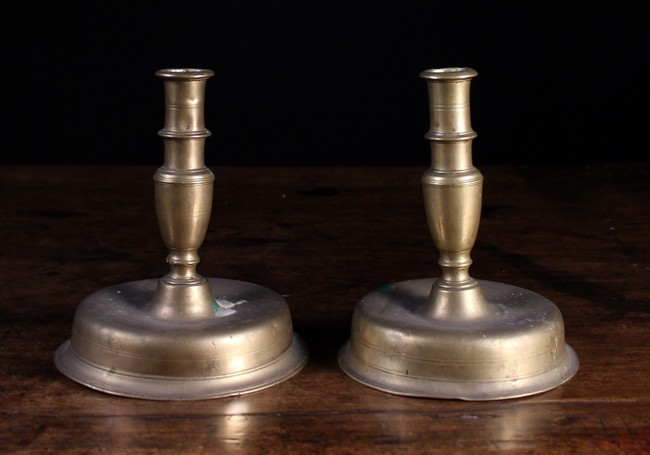 Lot 21 - A Pair of Late 17th/Early 18th Century Brass Candlesticks, 7¼ ins (18.5 cms) in height.