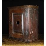 An 18th Century Joined Oak Wall Cabinet.