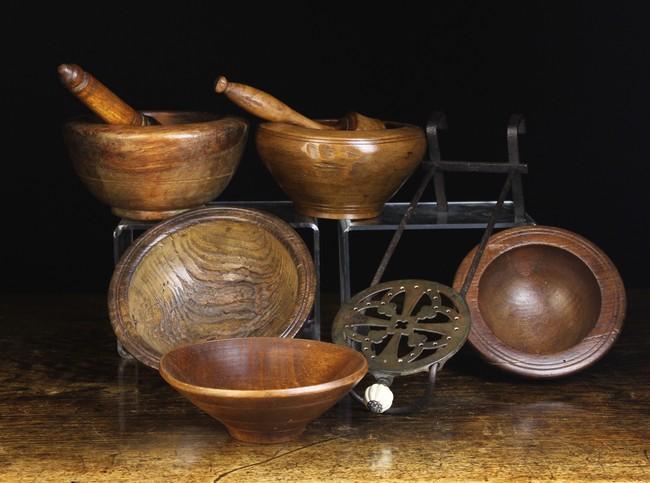 Lot 77 - Three Turned Treen Bowls, Two Treen Pestle & Mortars,