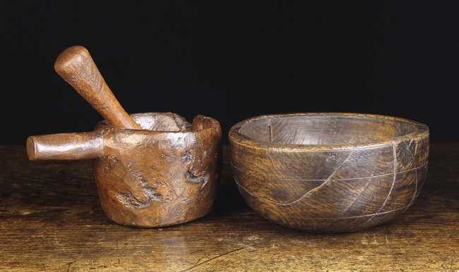 A Rustic Dug-out Mortar & Pestle, and a turned Elm Bowl (A/F).
