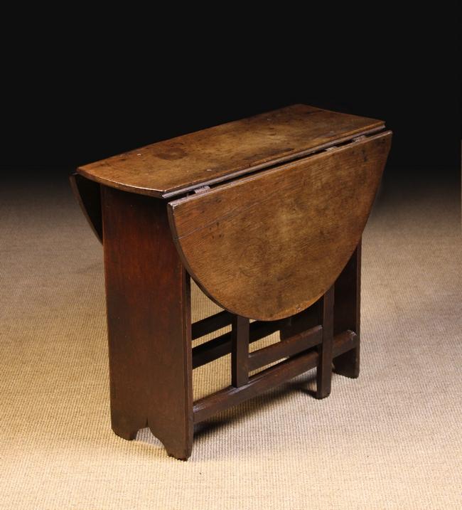 Lot 95 - A Small 18th Century Oak Drop leaf Table.