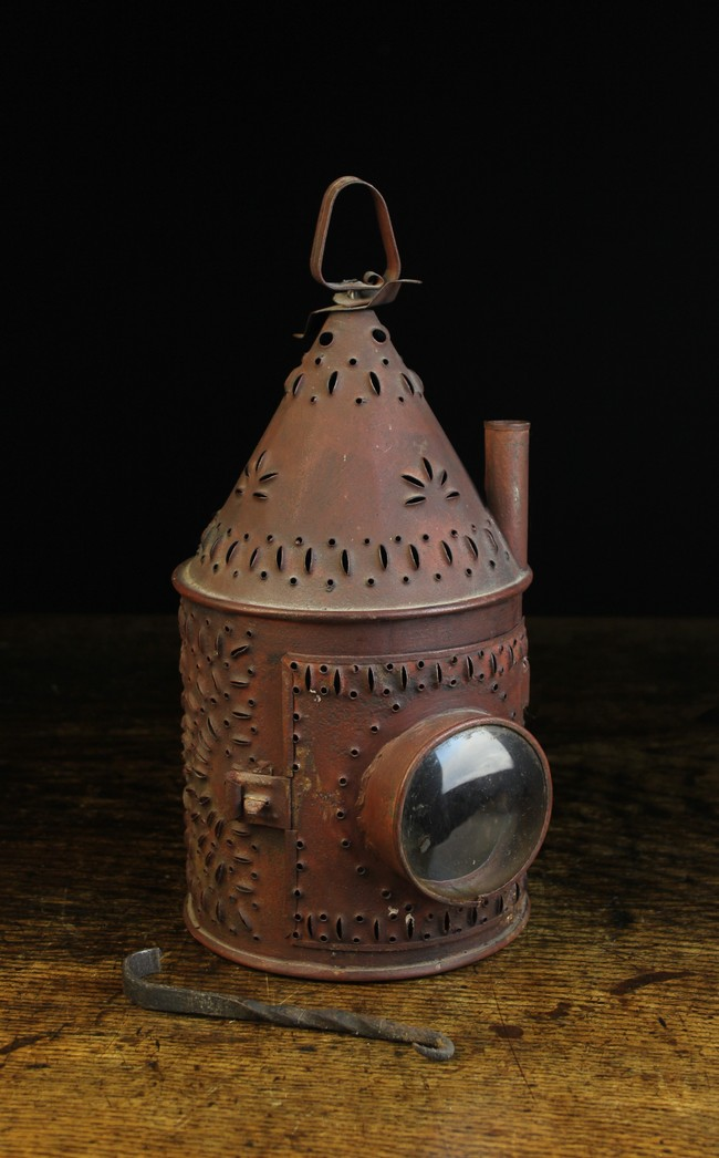 Lot 47 - An Early 19th Century Pierced Sheet Iron Hanging Lantern with decorative perforations.