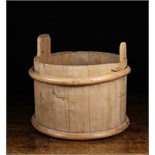 A Wooden Bucket composed of Pine Staves bound in willow withies;
