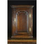 An 18th Century Oak Hanging Corner Cupboard.
