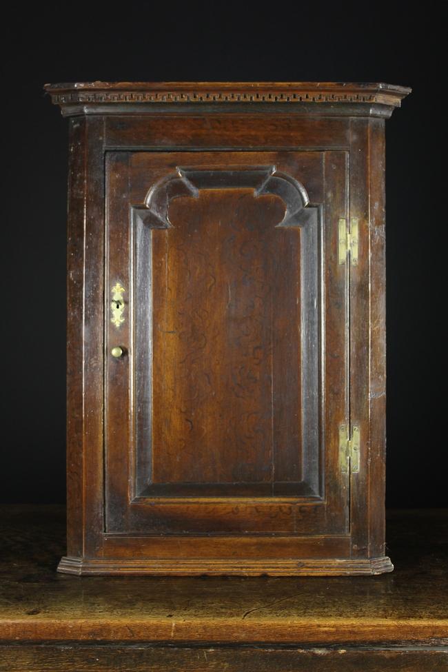 Lot 97 - An 18th Century Oak Hanging Corner Cupboard.
