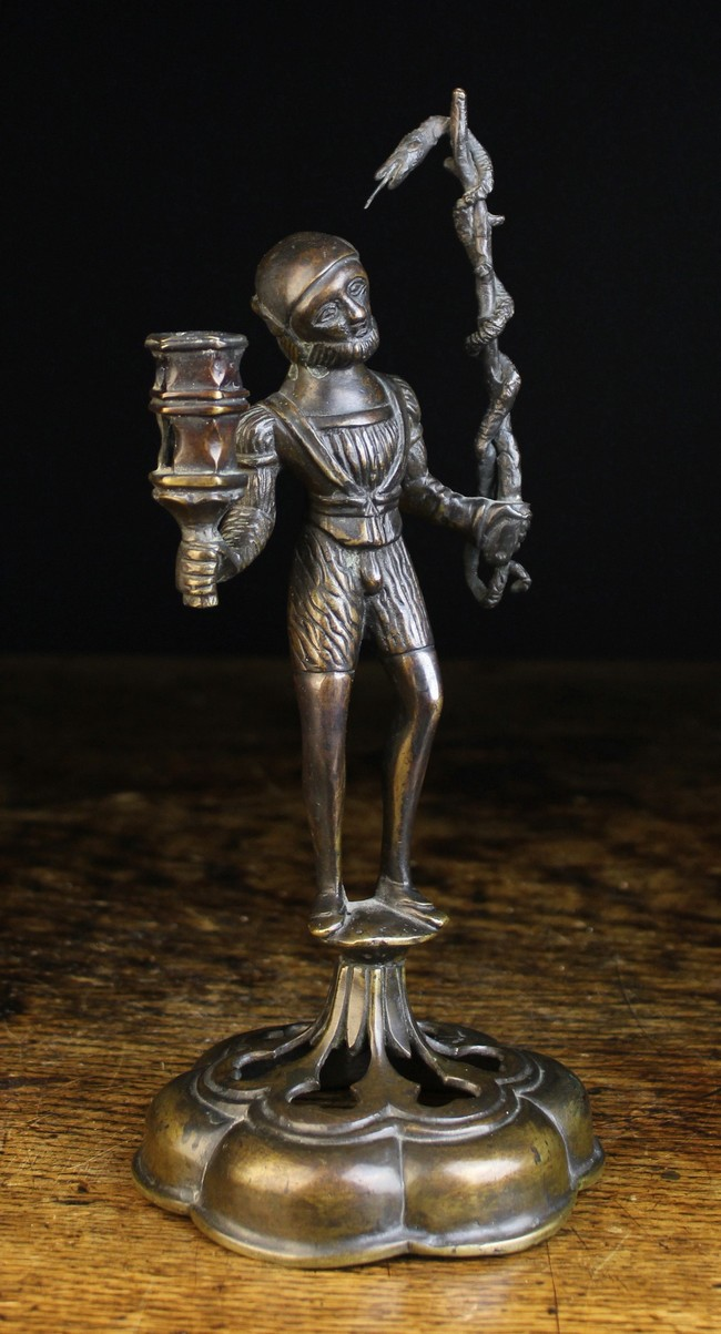 Lot 2 - An Antique Bronze Gothic Style Figural Candlestick of dark brown patination.