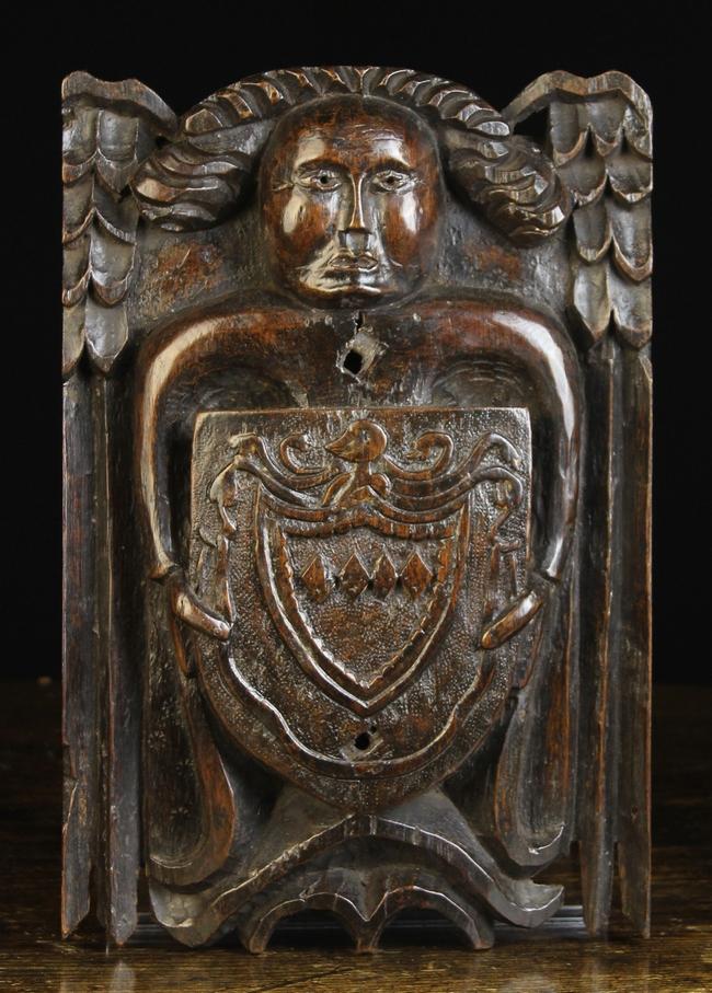 Lot 36 - A Fine 16th Century Carved Oak Beam Angel bearing a Heraldic shield,