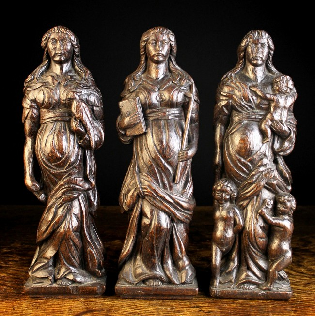 Lot 40 - A Set of Three 17th Century Flemish Carved Oak Allegorical Pilasters/Finial Figures personifying