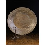 A Large 18th Century Turned Sycamore Platter (A/F) 20½ ins (52 cms) wide,