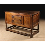 A 17th Century Joined Oak Table with enclosed Cupboard.