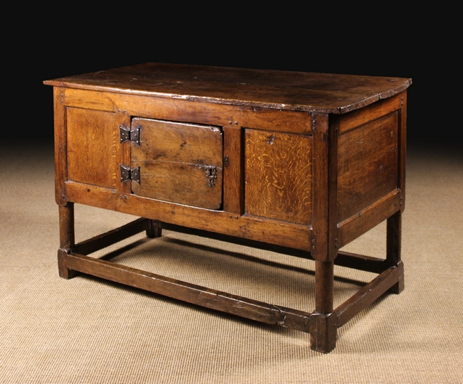 Lot 108 - A 17th Century Joined Oak Table with enclosed Cupboard.