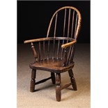 A 19th Century Child's Stick Back Windsor Armchair with residual paintwork.