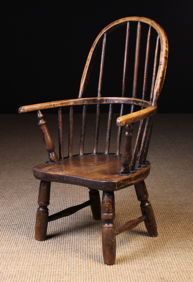Lot 103 - A 19th Century Child's Stick Back Windsor Armchair with residual paintwork.