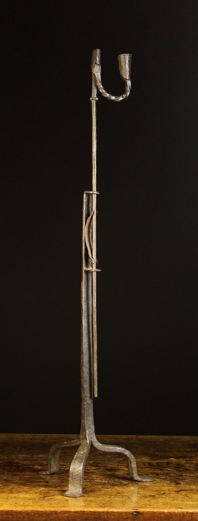 Lot 49 - An 18th Century Wrought Iron Corner Standard Rushnip / Candleholder.