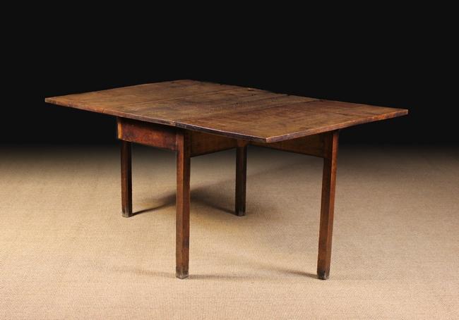 Lot 114 - A Late Georgian Oak Drop-leaf Dining Table.