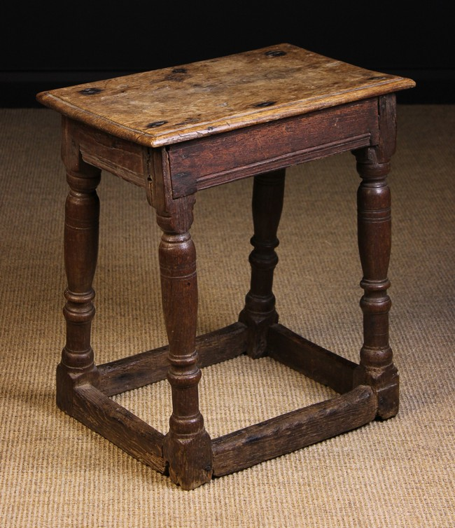 Lot 115 - A Late 17th/Early 18th Century Oak Joint Stool with a moulded top on baluster & reel turned legs