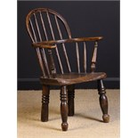 A 19th Century Child's Stick back Windsor Armchair, 25 ins (64 cms) high, 16 ins (41 cms) wide,