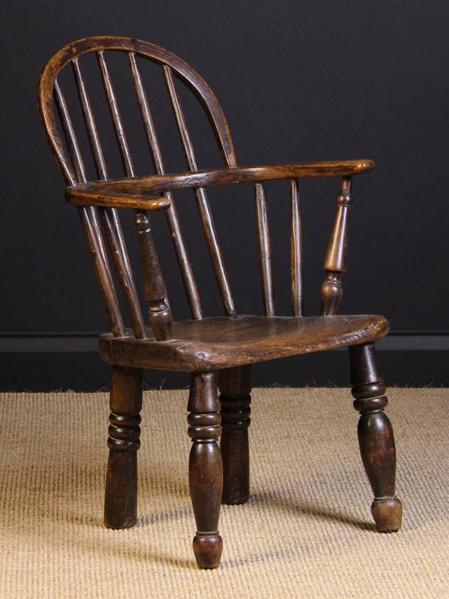 Lot 102 - A 19th Century Child's Stick back Windsor Armchair, 25 ins (64 cms) high, 16 ins (41 cms) wide,