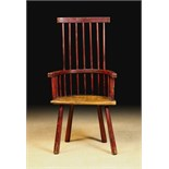 A Late 18th Century Comb Back Windsor Armchair with traces of residual red paint-work.