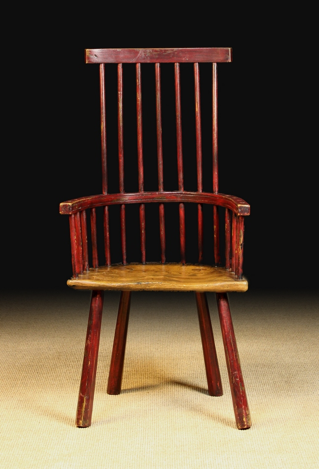 Lot 107 - A Late 18th Century Comb Back Windsor Armchair with traces of residual red paint-work.