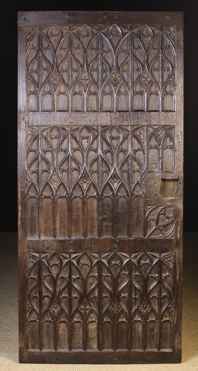 Lot 5 - A Late 15th Century Carved Oak Door enriched with Gothic Tracery,