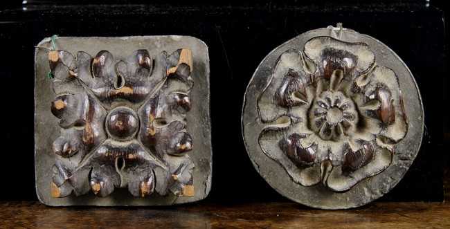 Lot 27 - Two Small Carved Wooden Bosses mounted on lead plaques: a Tudor rose 3 ins (8 cms) in diameter,