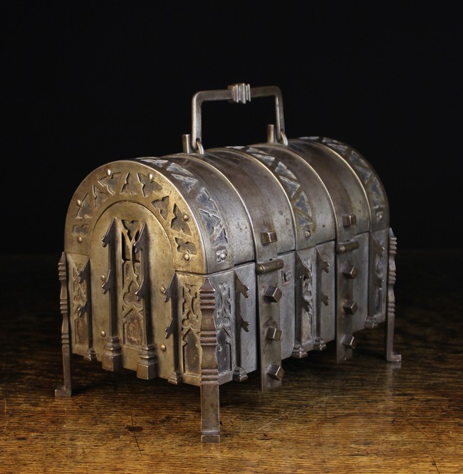 Lot 6 - A 19th Century German Dome-topped Steel Casket bound in decoratively pierced straps backed in