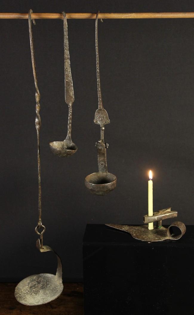 Lot 44 - Three 18th Century Wrought Iron Single Valve Pendant Oil Lamps, 21 ins (53 cms),