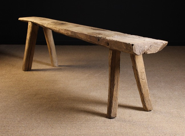 Lot 67 - A Long 19th Century Rustic Dry Elm Bench.