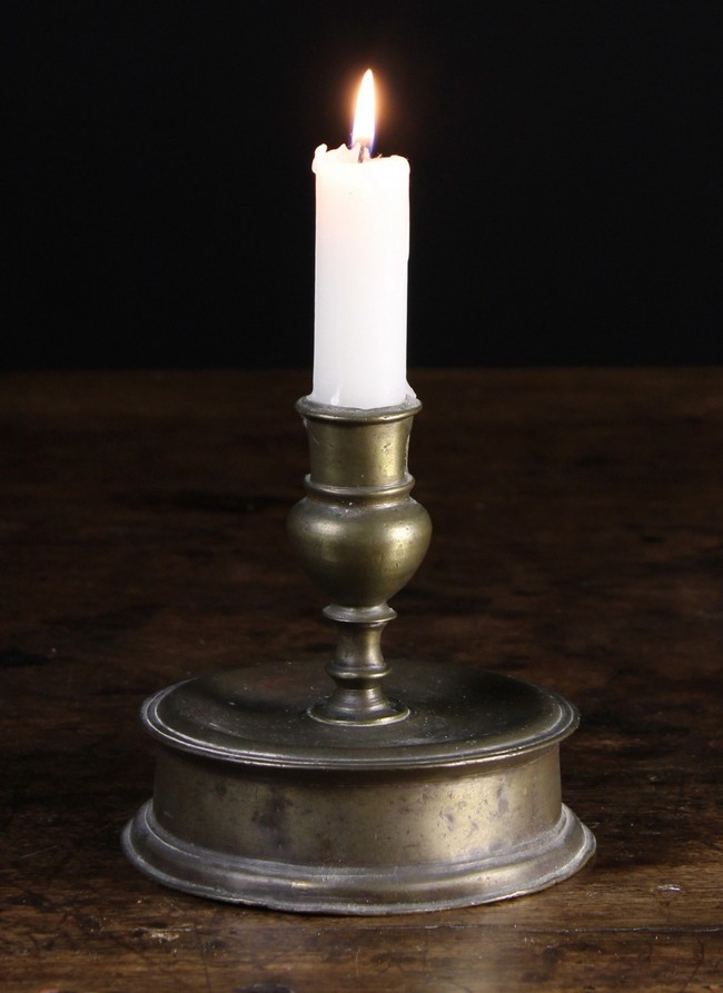 Lot 19 - A Mid 17th Century Reel-base Candlestick, probably Spanish, 5 ins (13 cms) in height.