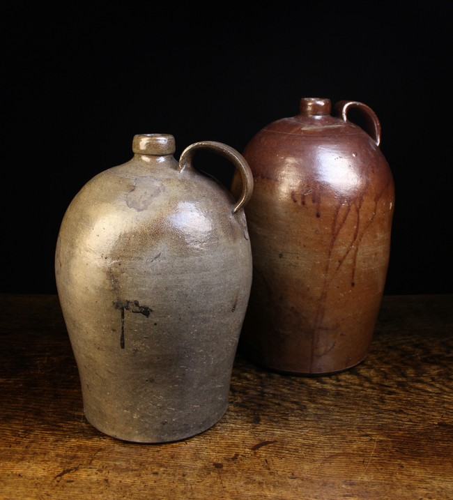 Lot 55 - Two Large 19th Century Stoneware Flagons with ring turned shoulders and moulded strap handles;